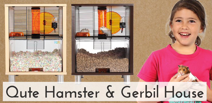 Girl smiling beside Qute Hamster and Gerbil Houses