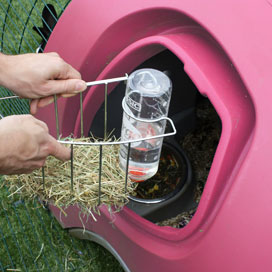 Removing the feeder and drinker from an Eglu rabbit house.